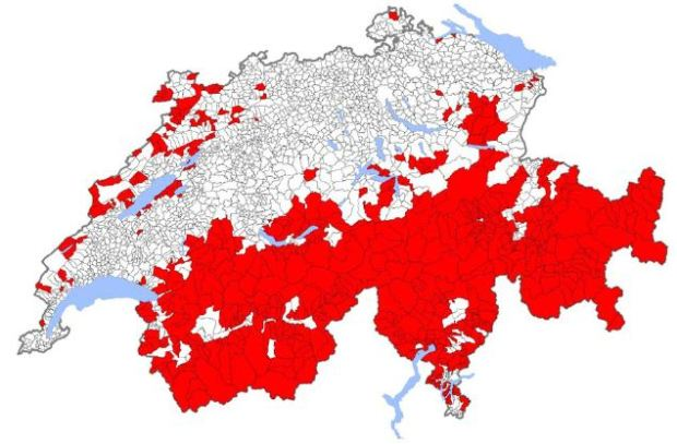 En rouge, communes suisses dont le pourcentage des residences secondaires par rapport au nombre total de logements est présumé supérieur á 20%